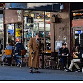 In the Street by Stewart Baird - City,  Street & Park  Street Scenes