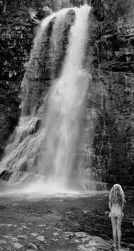 Adventure Awaits  by Cassidy Meade - Landscapes Waterscapes ( water, explore, girl, park, nature, waterscape, black and white, waterfall, swimming, glacier national park,  )