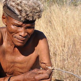 Building a Guinea Fowl Trap by Jaclyn T - People Portraits of Men ( life, simple, primal, africa, man )