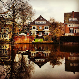 Gingerbread house. by Sonia Naiba - Buildings & Architecture Homes ( amsterdam, park, water, reflection, colors, sky, skyline, dutch, house, canal, double, lake, lines, ig, instagood, instamood, instatravel, traveling, instamoment, iphoneonly, iphoneography, photooftheday, picoftheday, bestoftheday, beautiful )