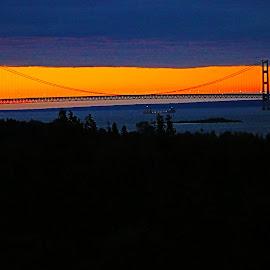 mac bridge by Scott Rochna - Buildings & Architecture Bridges & Suspended Structures ( water, orange, mackinac, mac, transportation, glow, up, michigan, tranquil, mackinaw, sunset, cars, sunrise, bridge, big mac )