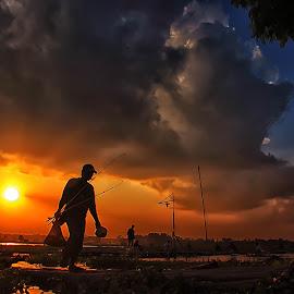 fisherman  by Yudi Kusumo Mulyo - Landscapes Sunsets & Sunrises ( home, fish, sunset, lake, fisherman )