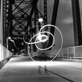Light carrier feet by Edith Melgar - Abstract Light Painting ( black and white, painting with light, fine art, bridge, flower )