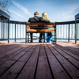 Looking Out by Blake Johnston - People Couples ( bench, wood, couple )