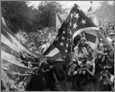 Verbrennen von USA Flaggen während Unruhen um Mohammed Karikaturen