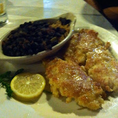 Macadamia crusted yellowtail snapper with black beans and rice.