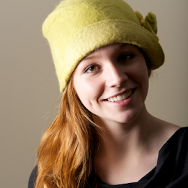 Smiling redhead with dimples in green hat by Nick Dale - People Fashion ( dimples, girl, felt, green, woman, redhead, smiling, portrait, black, hat )
