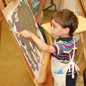 Young student in our Toddler 'Tiny Artist Painting' class