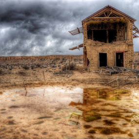 Old Watering Hole by Roch Hart - Buildings & Architecture Other Exteriors ( abandoned adobe clouds water reflection building clouds sky, abandoned, building )