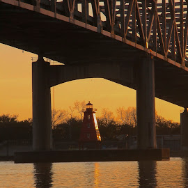 Lighthouse in the glow by Zeralda La Grange - Buildings & Architecture Other Exteriors ( #louisiana, #bridge, #lighthouse, #sunset, #water )
