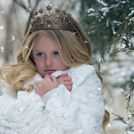 Snow princess by Carole Brown - Babies & Children Child Portraits ( little girl, blonde hair, crown, blue eyes, snowing )