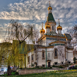 st. Nikolai churche  by Anton Donev - City,  Street & Park  City Parks ( famous, old, christianity, dome, willow, architecture, spring, religion, saint nikolay, sky, locations, buildings, bulgaria, clouds, church, orthodox, traditional, places, history, european, cities, blue, trees, day, sofia, culture )