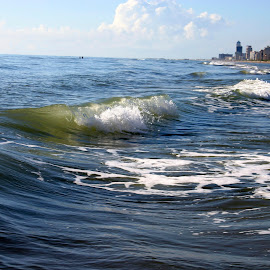 Waves rolling onto the beach with high rise condos and buldings  by Stretch Clendennen - Landscapes Waterscapes ( water, condo, building, waves, texas, sea, ocean, padre, beach, island, tide, south, surf,  )