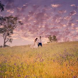 Walking in the Field by Alan Evans - Wedding Bride & Groom ( wedding photography, walking, purple, purple flowers, aj photography, field, wagga wagga wedding photographer, wedding, wedding day, trees, bride and groom, bride, groom,  )