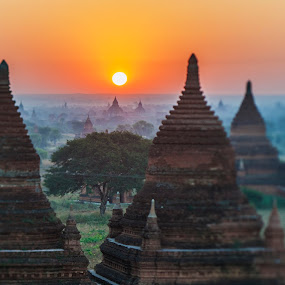 Sunrise over ancient Bagan, Myanmar by Oxana Chorna - Landscapes Sunsets & Sunrises ( famous, old, archaeological, mystery, pagoda, exterior, travel, architecture, landscape, burma, heritage, religion, mandalay, buddhism, adventure, ancient, asia, yangon, spirituality, indigenous, plain, place, built, top, site, structure, majestic, ethereal, pagan, traditional, tourism, dusk, buddha, temple, myanmar, dawn, shrine, sunset, praying, sunrise, view, ethnicity, culture, world )