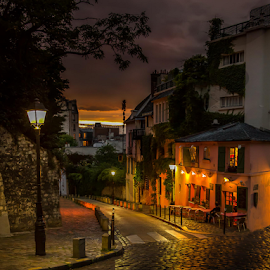 Montmartre Sunset by Sheldon Anderson - City,  Street & Park  Street Scenes ( nigh, paris, night photography, sunset, montmartre, romantic, cafe, cobblestone, , purple, yellow, color, Urban, City, Lifestyle )