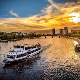 Boat Ride during sunset in Frankfurt by Charles Ong - Transportation Boats