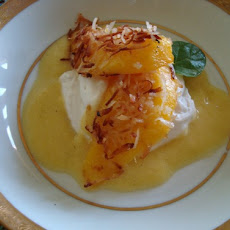 Coconut Crusted Mango Slices with Pineapple Sauce and Whipped Coconut Cream
