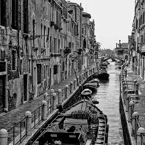Canal by Gene Myers - Black & White Buildings & Architecture ( shotsbygene, water, black and white, boats, venice, buildings, windows, cityscape, sidewak, canal, gene myers,  )