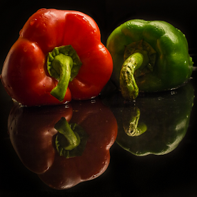Red & green peppers by Fredrik A. Kaada - Food & Drink Fruits & Vegetables ( contrast, reflection, red, details, green, food, art, vegetables, reflections, pepper, black )