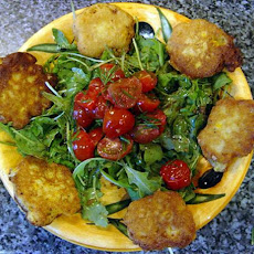 corn fritters w/arugula and warm tomatoes