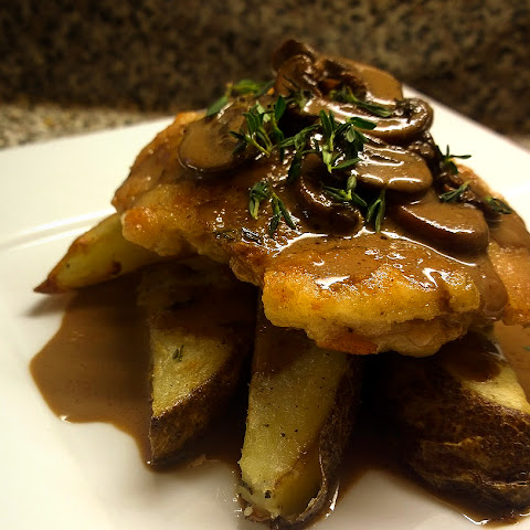 Chicken thighs, Rosemary wedges, and Thyme-balsamic mushroom cream sauce