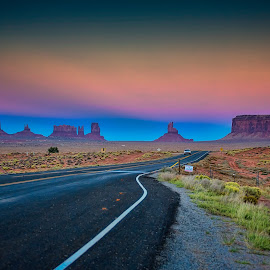 Driving The Monument Road by Stewart Baird - Landscapes Travel ( monument valley, red, blue, sunset, arizona, sundown, 2012, pink, road, usa )