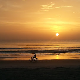 Alone at Sunrise by Valerie Bombino - Landscapes Beaches ( beaches, daytona beach, beach sunrise, beach, beach bike, bike riding on beach,  )