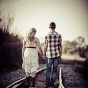 Railroad by Johan Niemand - People Couples ( engage, hands, rail, couple, walk )