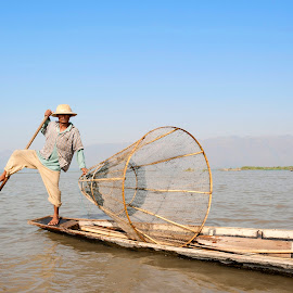 Lake Inle by Diego Scaglione - People Portraits of Men ( blue, feet, boat, man, river )