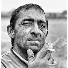 worker by Nikola Hrzenjak - People Portraits of Men ( cigarette, field, black and white, worker, man )