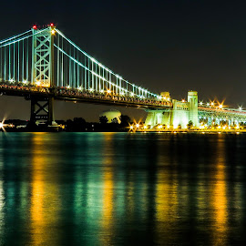 Ben Franklin Bridge by Vaibhav Jain - Buildings & Architecture Bridges & Suspended Structures ( water, building, color, phili, camden, night, lake, road, bridge, ben franklin bridge, light, river )