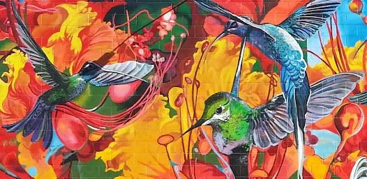 Images of desert hummingbirds are dominant in Ponsler's mural.