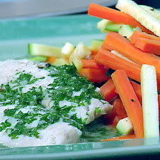 Sea Bass Poached in a Court Bouillon with Sauteed Batonnet of Carrots and Zucchini