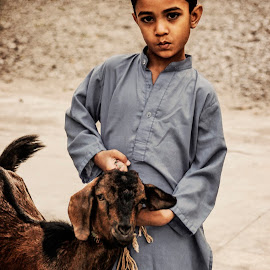 It's Mine by Junaid Ahmad - Babies & Children Children Candids ( pakistan, candid, peshawar, animal, kid )