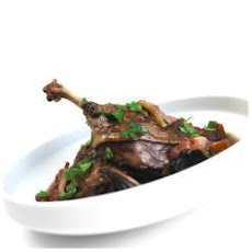 Slow Roasted Duck Legs With A Red Wine And Mushroom Sauce