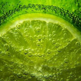 Breathing LIME by Blerim Havolli - Food & Drink Fruits & Vegetables ( fruit, havolli, green, fruits, blerim, glass, lemoon, lime, buble, in,  )