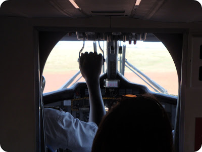 taking off in a plane in the masai mara