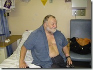 Dave on his bed in hospital.