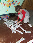 Child puts together a skeleton puzzle