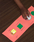 Children touch a flat paper square and circle, and a sphere (ball) and cube (block).