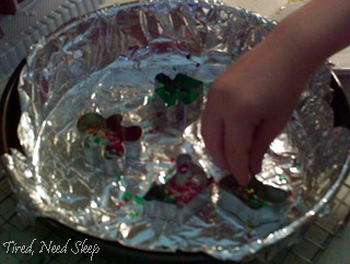 filling the cookie cutters up with beads