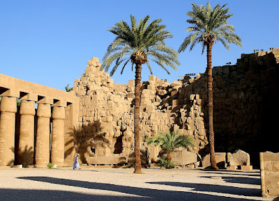 A man walks alone through Karnak Temple in Luxor, Egypt