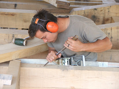 "... "" with a chisel on a white oak window stud for this oak timber frame"