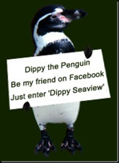Dippy holding Facebook sign