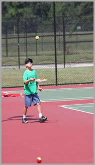 Landon at tennis lessons 2009