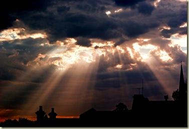 sunburst over terrace houses by CragPJ