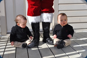 Santa - boys sitting with boots
