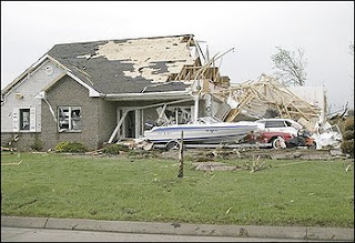 A home in the Lakeside Estates is badly damaged after a tornado ripped through Adair County Wednesday evening May 13, 2009, causing extensive damage to Kirksville, Missouri. The city of Kirksville apparently took the hardest hit. Police Det. Sgt. Ron Celian said about 30 to 40 homes were damaged, one was destroyed and an auto dealership sustained significant damage. Two people were injured near the dealership when their car was blown off the road, Celian said. (AP Photo/Al Maglio)