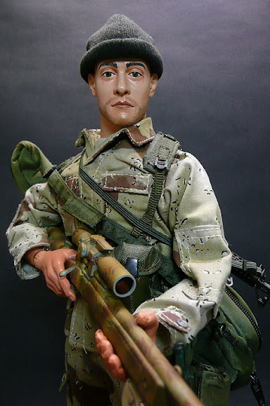 Jake Gyllenhaal as USMC Scout Sniper Swofford
